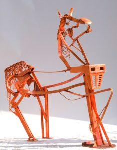 New York's Saratoga Polo shows Horse sculpture named Pot' ente.