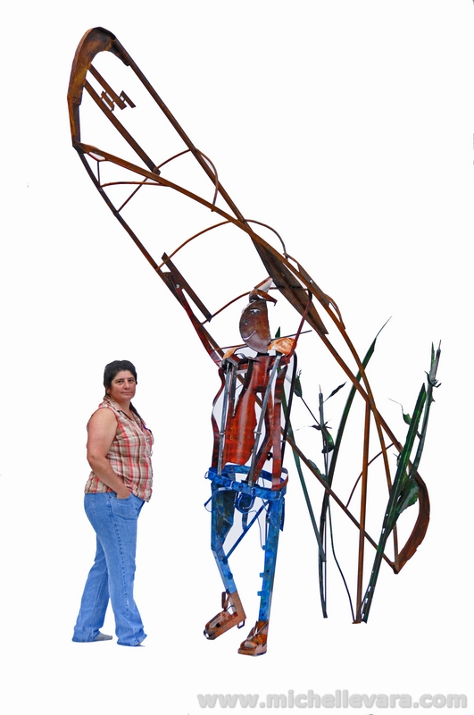 Artist miChelle Vara and finished sculpture