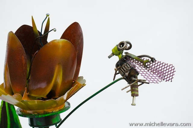 Large Tulips and bee's made from recycled welded material.