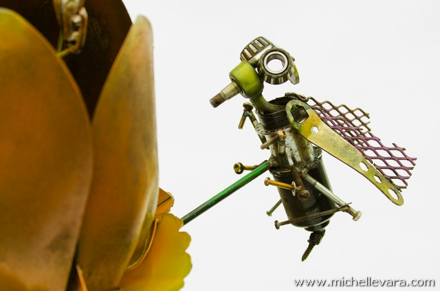 Large Tulips and bee's made from recycled welded material, finished in handmade paint.