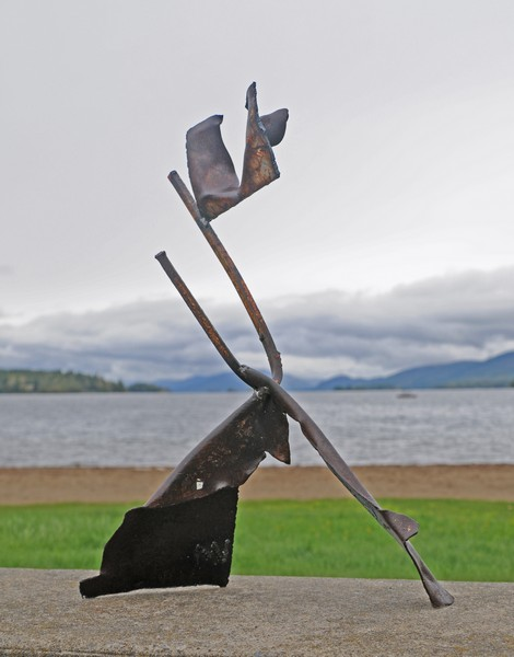 metal sculpture depicting Joy