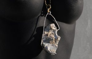 "622J. Magdal side 2-""Tower"" or ""Castle"" within is an English sea rock silver brass and steel sculpture that can be worn."