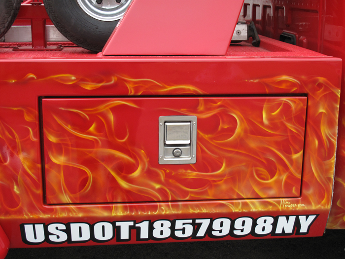 tow truck airbrushed with real flames on Red