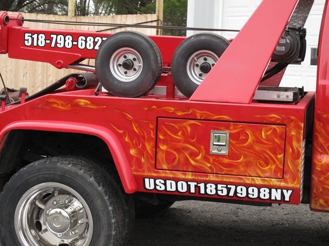 tow truck airbrushed with real flames