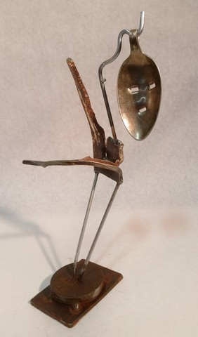 Spoon Art, metals welded with enamel paint accents. Sculpture that wears like Jewelry.