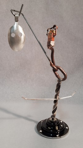 Kachina, metals welded with enamel paint accents. Sculpture that wears like Jewelry.