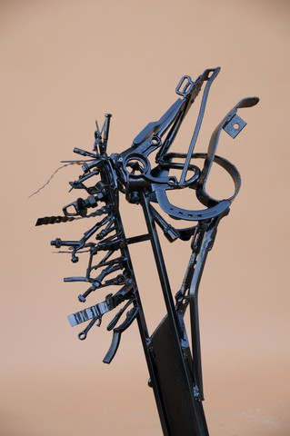 Horse sculpture mad from recycled metal and painted with epoxy.