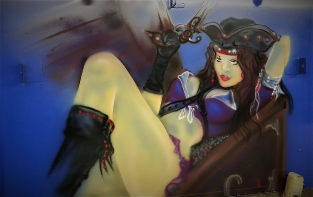 Airbrush woman pirates on any surface.